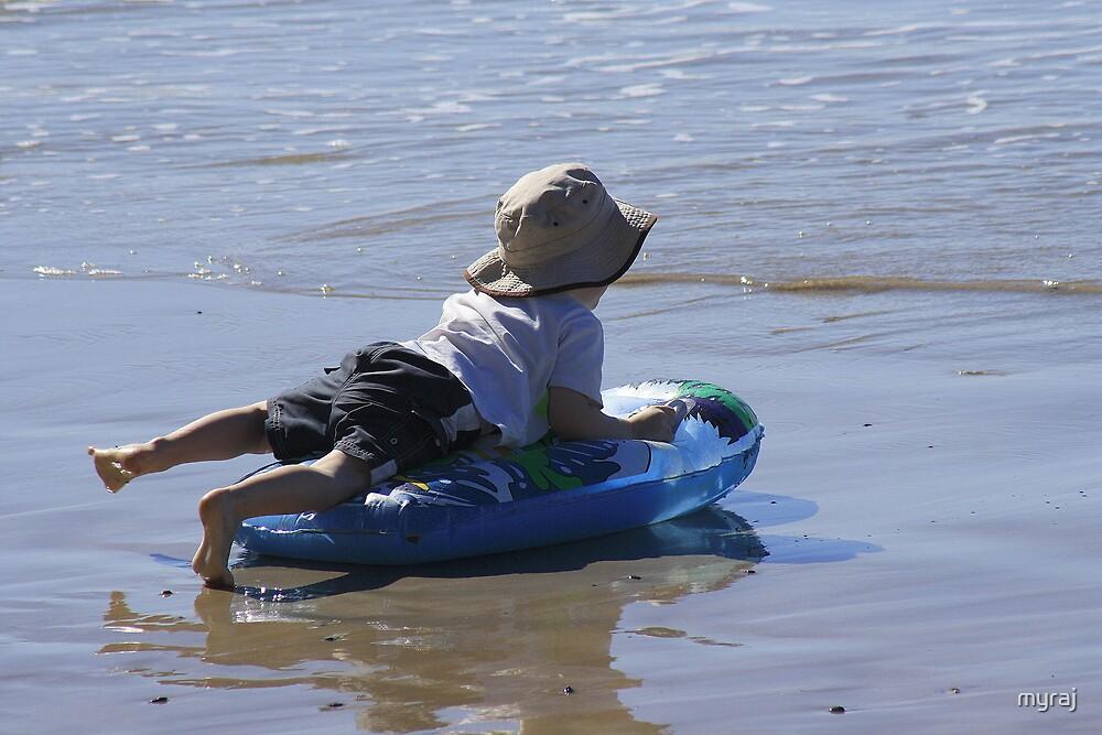 Surfing at Brooms Head Beach by myraj