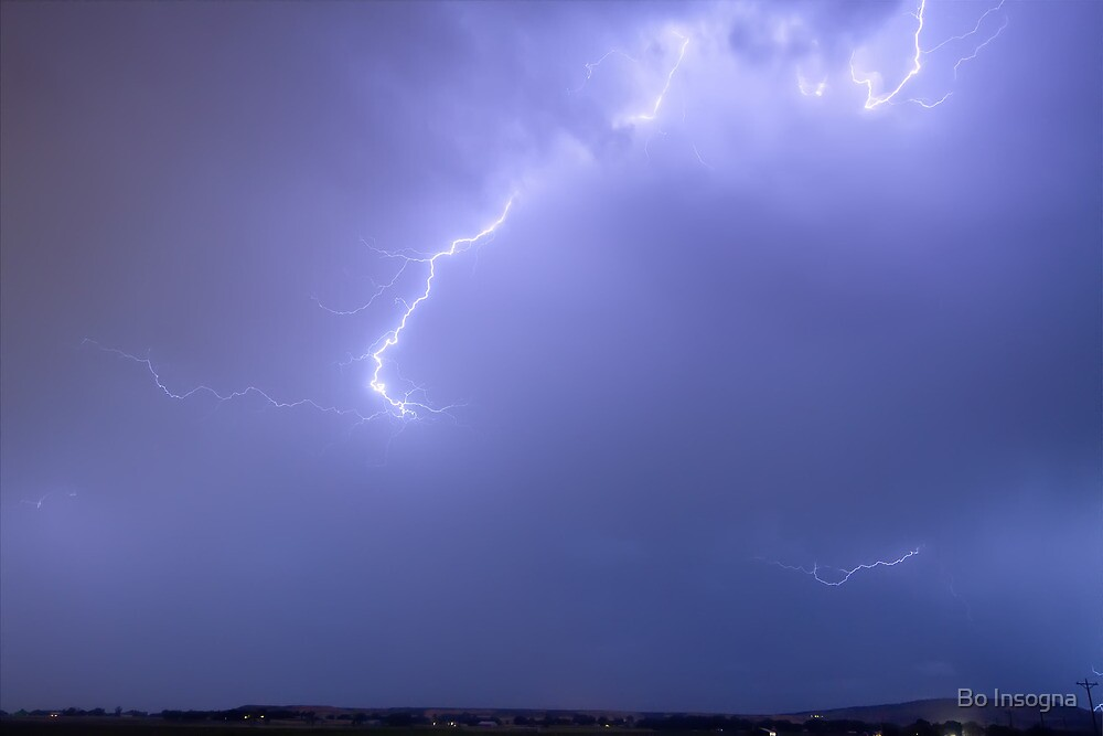 Bolts of Lightning Arcing Through the Night Sky by Bo Insogna
