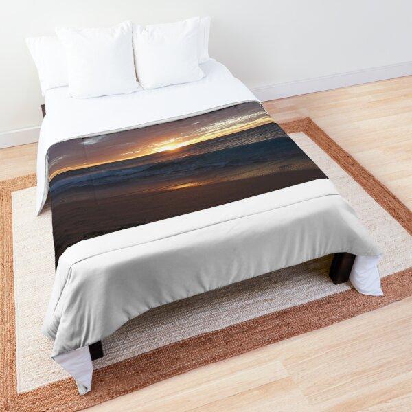 Setting sun illuminates waves Comforter