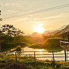 Sunset behind the Mountains in Vang Vieng by MichaelDarn
