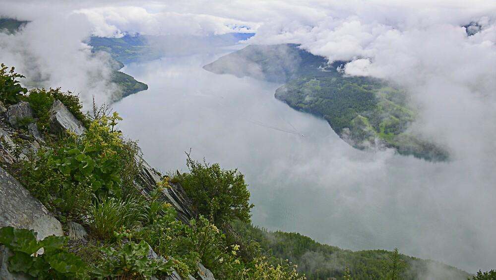 Lake Kanas enveloped by clouds by Brian Bo Mei