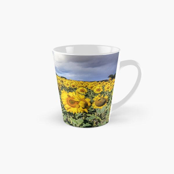 Field Of Sunflowers With A Blue Sky And Clouds Tall Mug