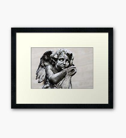 Sad Little Angel Framed Print