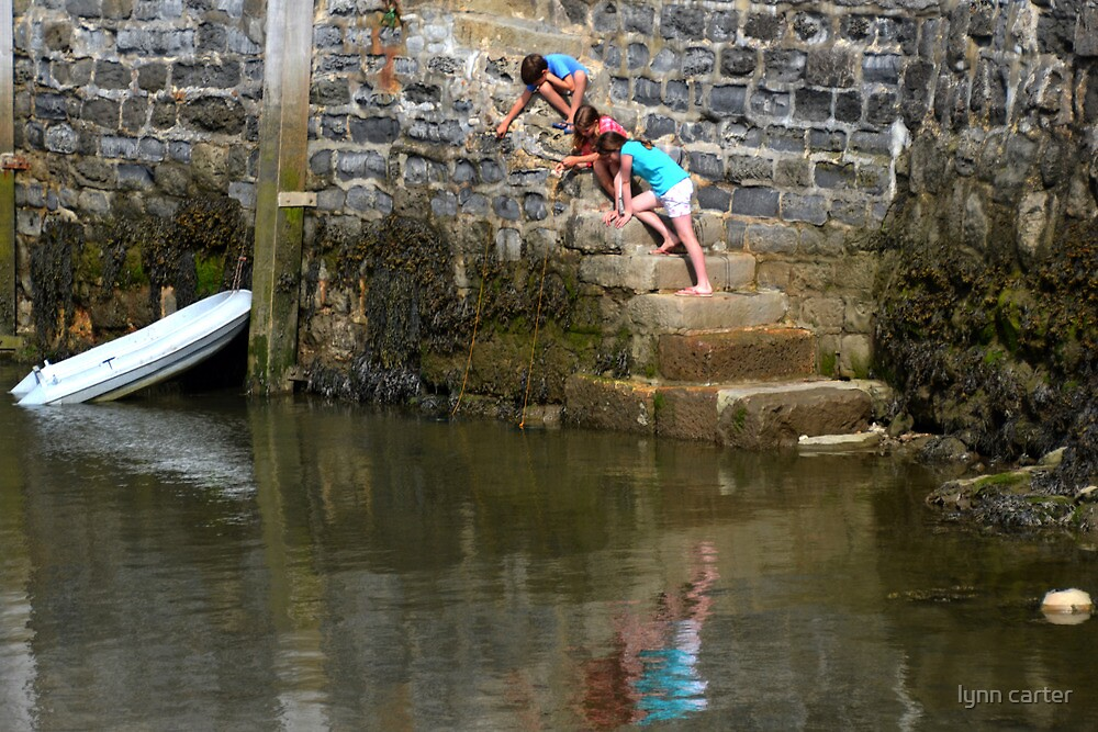 Kids Fishing For Crabs At Lyme,Dorset,UK by lynn carter