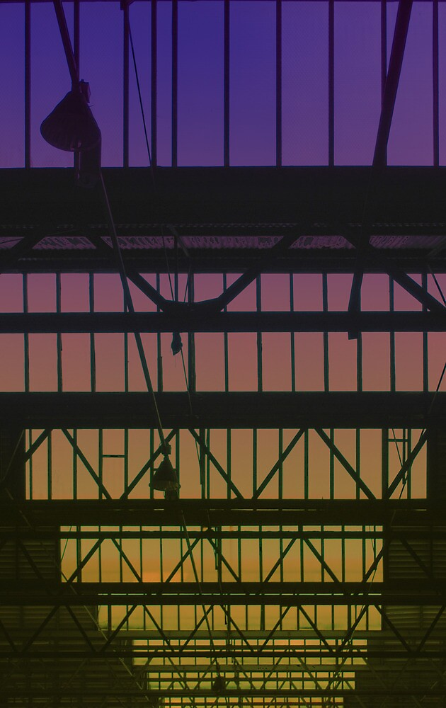 Sunset through the rafters by Mark Malinowski