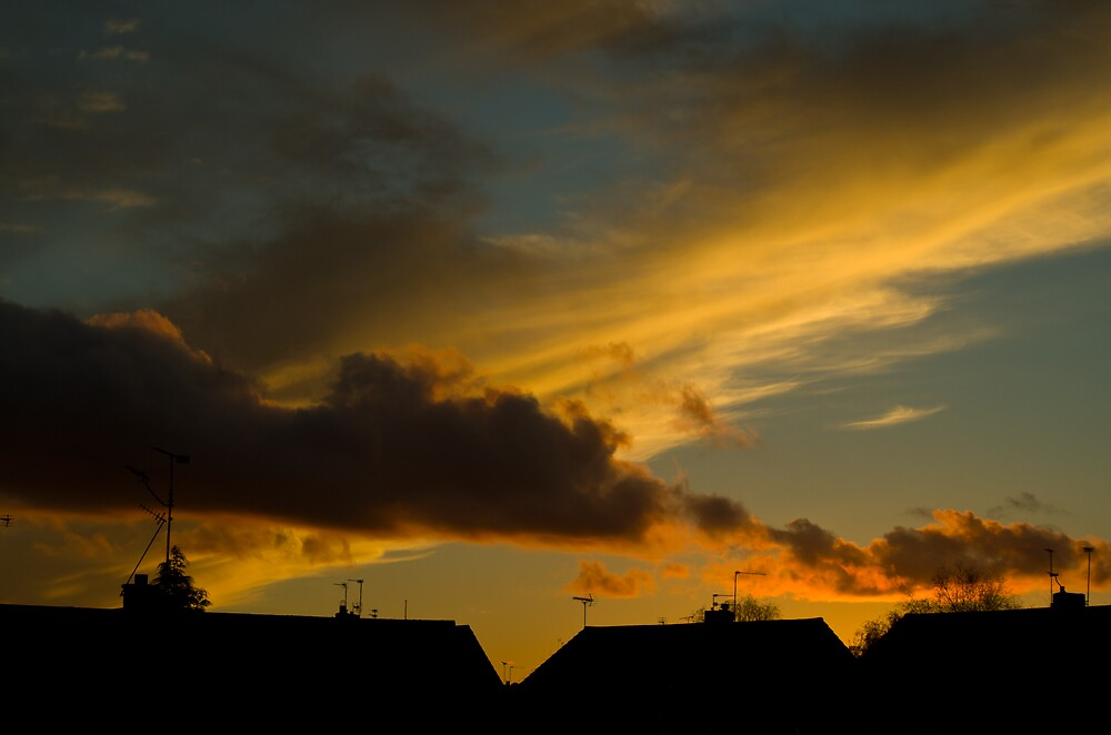 Sunrise over houses by Kevin Cartwright