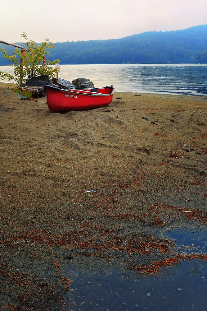 Red Canoe on a Beach by Nazareth