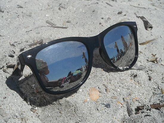 Sunglasses in the Sand by Molly Quinn
