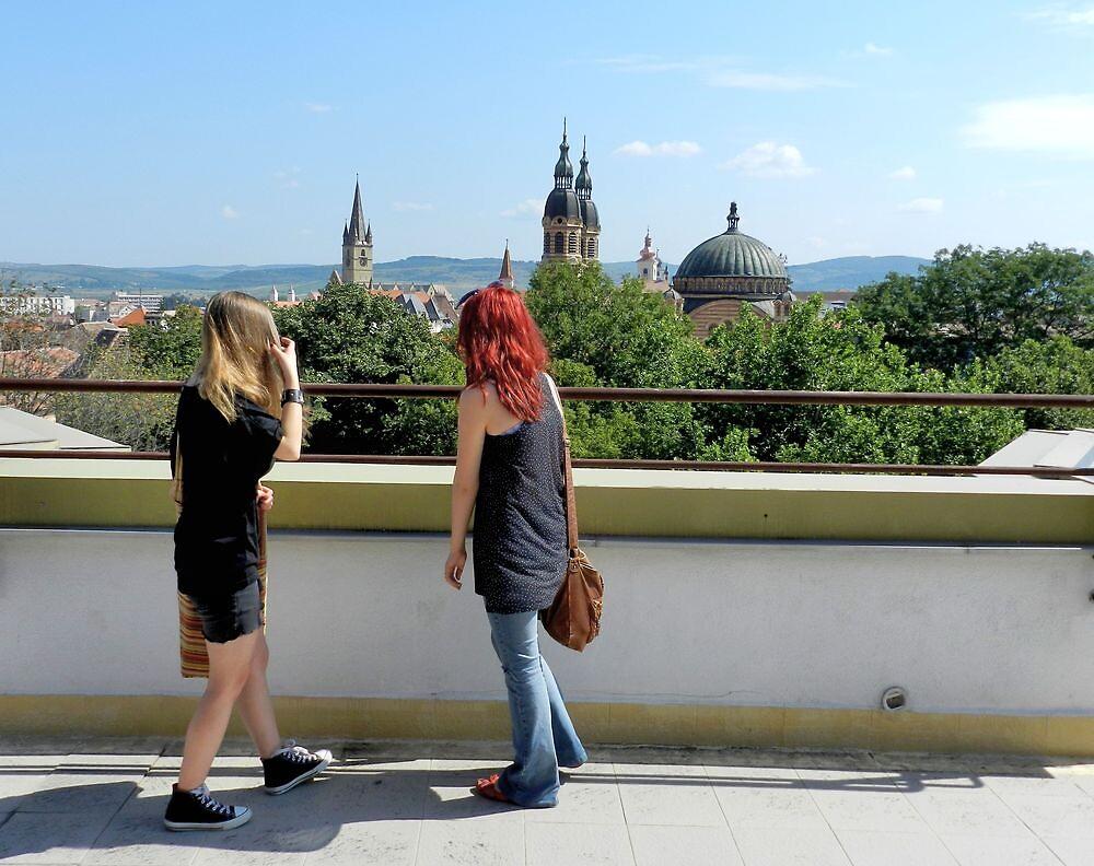 Blonde and Red Hair Girls Admiring Sibiu Roofs by ivDAnu