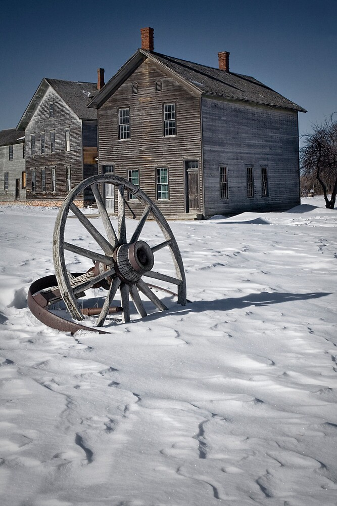 Wagon wheel in winter at the mining ghost town at Fayette by Randall Nyhof