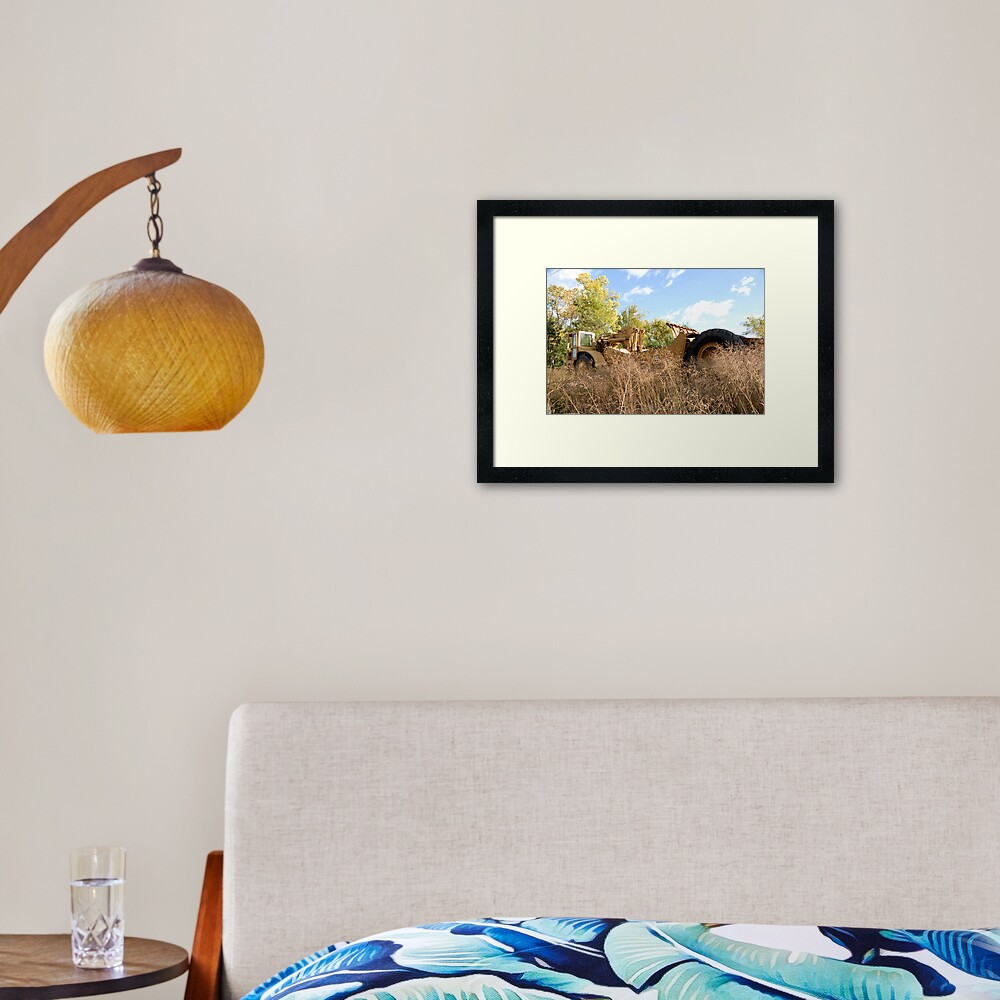 Land Grader parked in the grass Framed Art Print