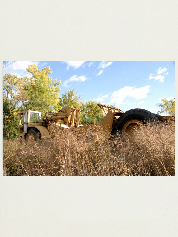 Alternate view of Land Grader parked in the grass Photographic Print