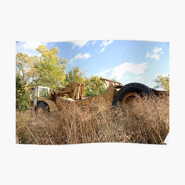 Land Grader parked in the grass Poster
