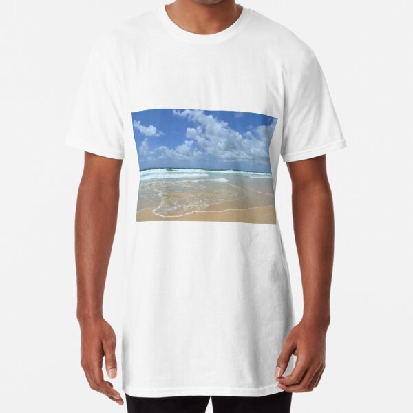 Gentle waves on a sandy beach, against a blue sky. Long T-Shirt