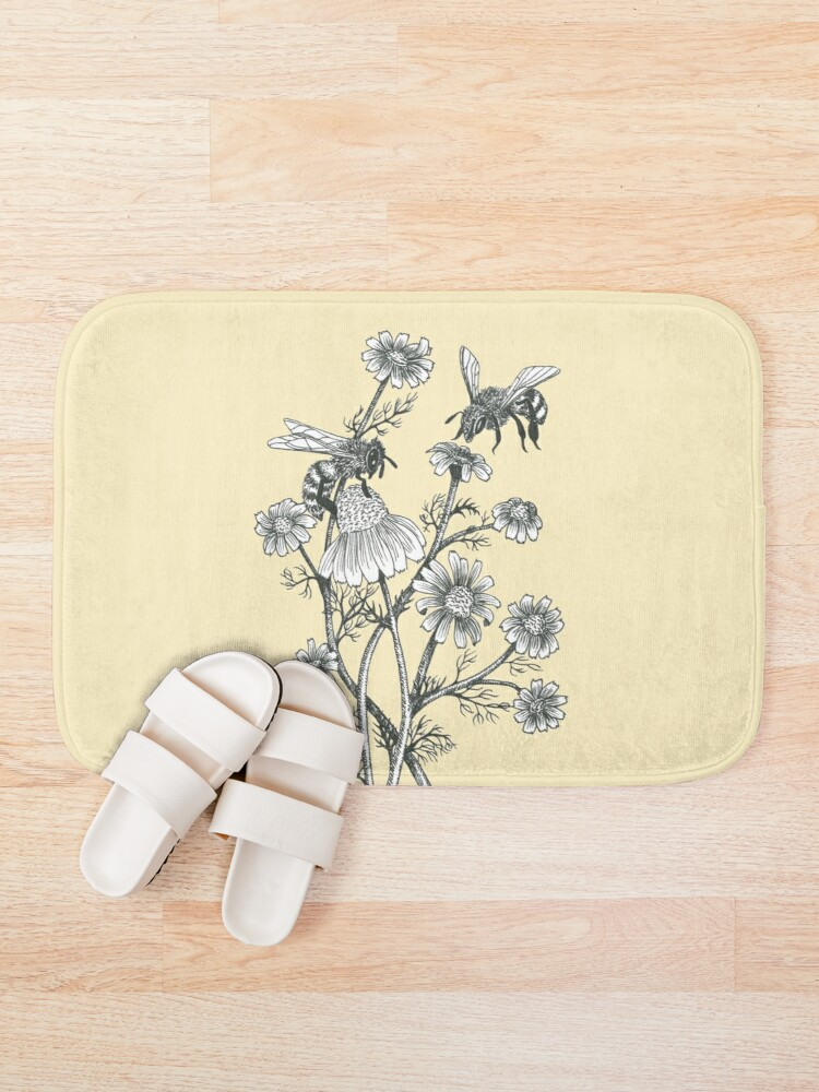 Alternate view of bees and chamomile on honey background  Bath Mat