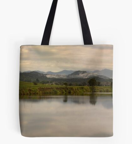 It's not easy to walk alone in the country without musing about something. Tote Bag