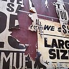 Torn old posters by sledgehammer
