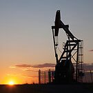 Silhouetted Pump Jack by printscapes