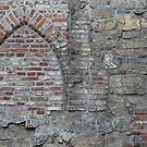 Medieval church now part of wall. Oslo old town. by UpNorthPhoto