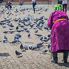 Feeding the pigeons at Gandan Monastery by Ruben D. Mascaro