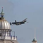 The Lancaster flies across the pier in Eastbourne by Keith Larby