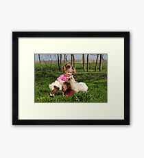 child play with two little goats Framed Print