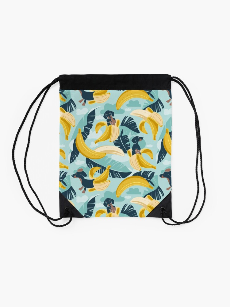 Alternate view of Surrealistic tropical Dachshund bananas // aqua background navy blue dogs and banana fruit leaves Drawstring Bag