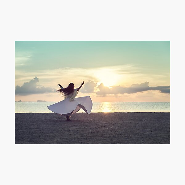 Woman Dancing on the Beach at Sunset Photographic Print