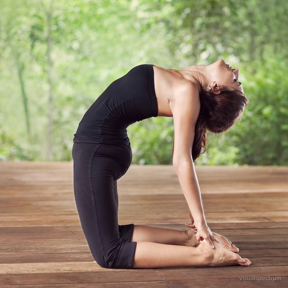 Pretty Woman Doing Yoga Camel Pose by visualspectrum
