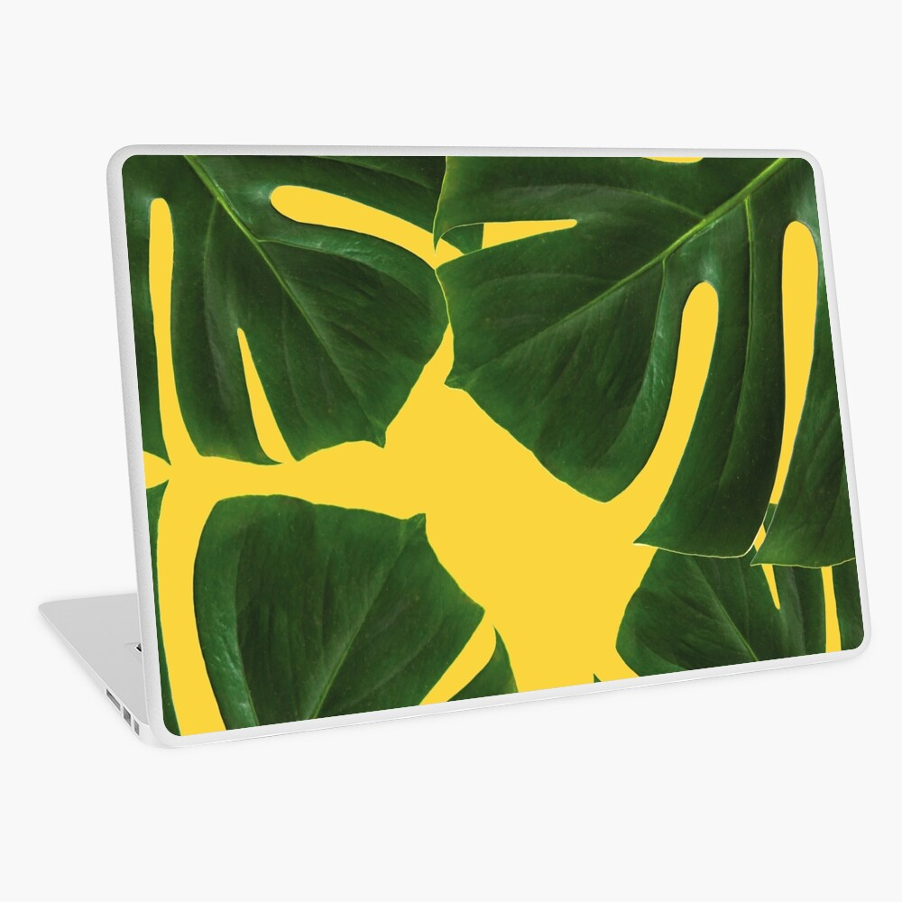 Graphic green palm leaves, yellow background Laptop Skin
