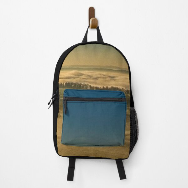 Beautiful city in the fog with sun rays autumn photography Backpack