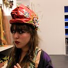 The Model in the Paper Maché Hat by Rebecca Dru