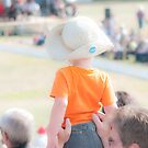 Now I Can See - Child Enjoying the RCMP Musical Ride by Daphne Eze
