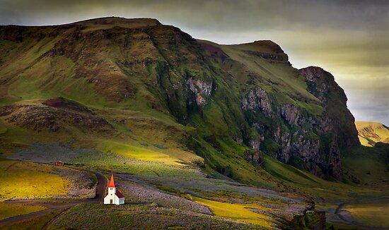 Last light on Vik kirkja by Karen Scrimes