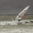 Sun glinting on a windsurfer by Judi Lion