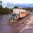 Truck crossing Ord River in flood by JuliaKHarwood