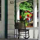 Suburbs - Porch With Rocking Chair and Geraniums by Susan Savad