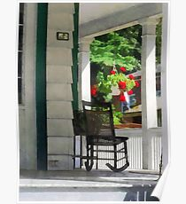 Suburbs - Porch With Rocking Chair and Geraniums Poster