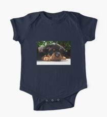 Cute Close Up Of A Sleepy Rottweiler Puppy Kids Clothes