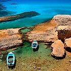 Natural rocky harbor in Milos island by Hercules Milas