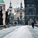 Snow on Prague's Charles Bridge with a hint of color by Jennifer Lyn