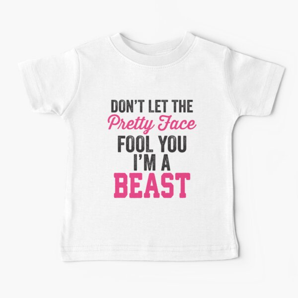 Don't Let The Pretty Face Fool You I'm A Beast (Pink) Baby T-Shirt