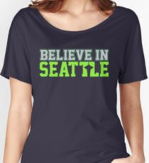 """VICTRS """"Believe In Seattle"""" Women's Relaxed Fit T-Shirt"""