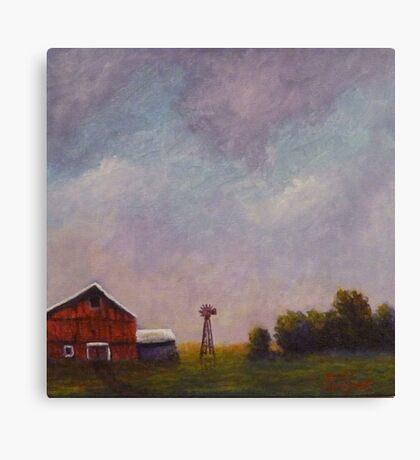 Windmill farm under a stormy sky. Canvas Print