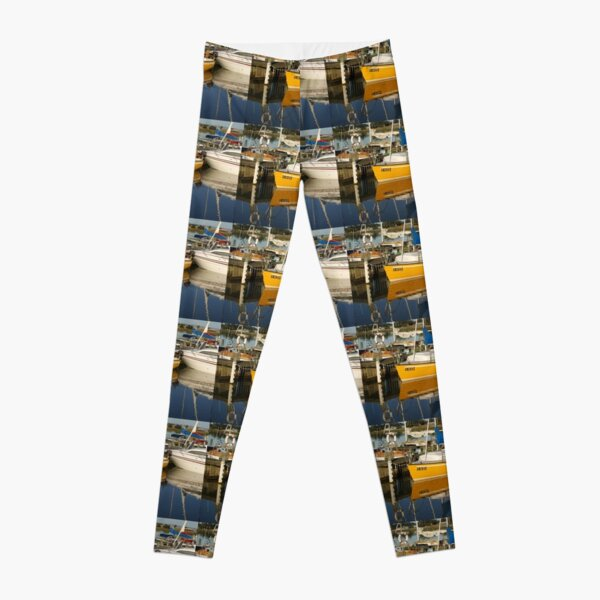 Yellow Yacht Reflection by Avril Thomas Leggings
