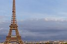 Eiffel tower on a cloudy sky in Paris by OlivierImages