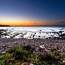 The Bay's Rocky Shore by John Sharp