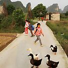 Yangshuo children and ducks by Robyn Lakeman
