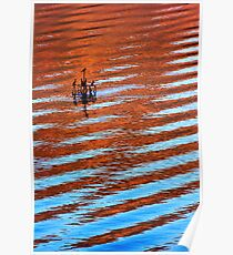 Mountains reflected on a wavy lake surface Poster
