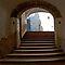 Steps through an archway